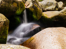 Blurred river stream detail. Of wild rocky mountain river. Silky effect. Motion rendition effect. Slow shutter speed effect. Long exposure effect Stock Image