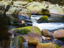 Blurred river stream detail. Of wild rocky mountain river. Silky effect. Motion rendition effect. Slow shutter speed effect. Long exposure effect Stock Photography