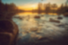 Blurred river sunset background royalty free stock photo