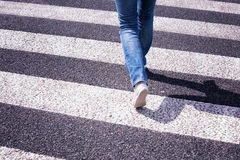 Blurred road crossing with pedestrian feet Royalty Free Stock Image