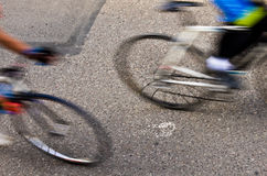 Blurred road cyclists royalty free stock photography