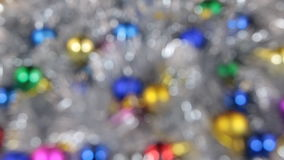 Blurred, the rotation of Christmas balls and silvery tinsel stock video