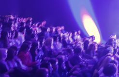 Blurred rows of people sitting at event abstract royalty free stock photos