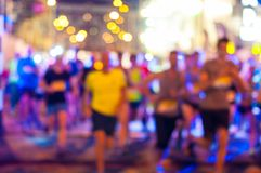 Blurred Runners shortly after the start at night Royalty Free Stock Photo