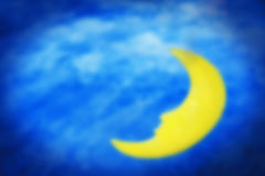 Blurred scene of sleeping moon with night sky background. Stock Images