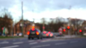 Blurred Scene of Unfocused Cars on Intersection. With Red Traffic Lights and Break Lights stock footage