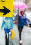 Blurred scene of urban life. Rain in the city. Blurred scene of urban life. Emotional abstract background with defocused people on the streets of New York on a stock image