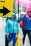 Blurred scene of urban life. Rain in the city. Blurred scene of urban life. Emotional abstract background with defocused people on the streets of New York on a stock photos