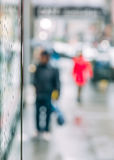 Blurred scene of urban life. Rain in the city. Blurred scene of urban life. Emotional abstract background with defocused people on the streets of New York on a royalty free stock photos