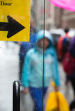 Blurred scene of urban life. Rain in the city. Blurred scene of urban life. Emotional abstract background with defocused people on the streets of New York on a stock photography