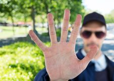blurred security guard saying stop with his hand in the park Stock Photography