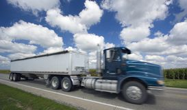 Blurred semi-truck under crazy clouds Royalty Free Stock Photo