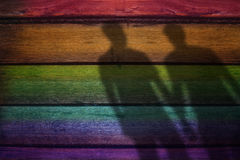 Blurred Shadow Shape of male lover on Rainbow Colored plank Wood. En Background, Gay or Homosexual Concept stock images