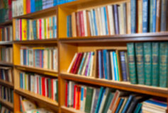 Blurred shelf with books. Background. the image was blurred for use as a background Royalty Free Stock Photo