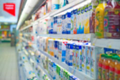 Blurred shelves with milk products. Stock Photos