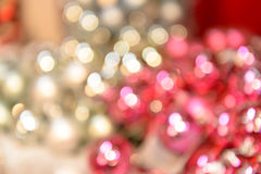 Blurred shiny silver and pink Christmas background. Balls Stock Images