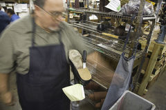 Blurred Shoemaker In Workshop Stock Photo