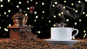Blurred shooting. White cup drink with smoke and coffee grinder stock video footage