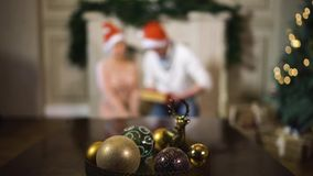 Blurred shooting of Young couple with Christmas tree stock footage