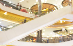 Blurred of shopping mall escalator and people Stock Photo