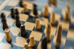 Blurred shot chess battle with all the focus on one pawn who is royalty free stock images