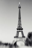 Blurred shot of the Eiffel Tower in Paris, France. Selective focus on details. Lensbaby photo of Eiffel Tower, black and white colors stock photo