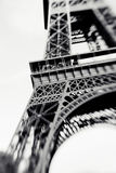 Blurred shot of the Eiffel Tower in Paris, France. Selective focus on details. Lensbaby photo of Eiffel Tower, vintage black and white colors stock photo