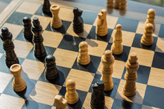 Blurred shot showing a chess battle taking place with two teams Stock Photos
