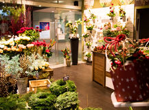 Blurred shot of small florist shop selling Christmas decoration, presents and flowers Stock Photos