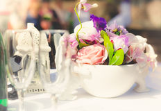 Blurred shot of table at wedding decorated by flowers Royalty Free Stock Photography