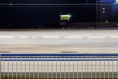 Blurred side of train motion movement running in station stock image