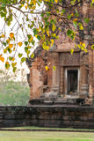 Blurred Sikhoraphum Khmer Ruin with Bodhi leaf in the foreground. Thailand Royalty Free Stock Photos