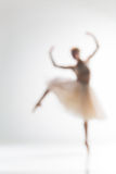 Blurred silhouette of ballerina on white background Royalty Free Stock Photos