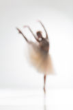 Blurred silhouette of ballerina on white background Stock Image