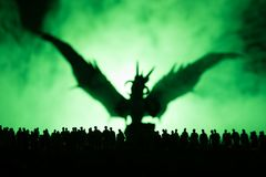 Blurred silhouette of giant monster prepare attack crowd during night. Selective focus. Decoration. Blurred silhouette of giant monster prepare attack crowd stock photos