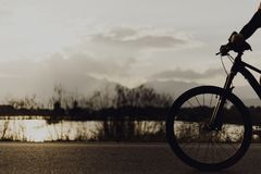 Bicycles outdoor. Blurred silhouette of people Image of sporty company on bicycles outdoors against sunset motion Stock Image