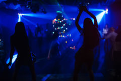 Blurred silhouettes of two dancers on stage at the club at the party Royalty Free Stock Image