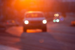 Blurred silhuette of a car at sunset Royalty Free Stock Photography