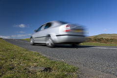 Blurred silver car. On the mountain road. Dartmoor, Devon, England Royalty Free Stock Images