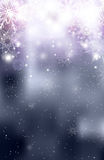 Blurred silver Christmas winter background with sparkles. And snowflakes Stock Photos