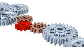 Blurred Silver Gears with one Red Royalty Free Stock Photo