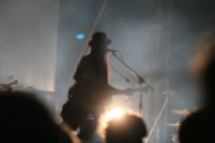 Blurred singer in night concert.  Stock Photo