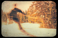 Blurred skier retro effect Stock Images