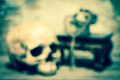 Blurred skull and rosary ( cross process ) Royalty Free Stock Photography