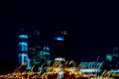 Blurred skyscrapers. Multistory buildings at night, Illuminated windows. Modern neon city at car speed Stock Images