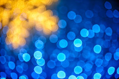 Blurred snowflake and blue lights Stock Images