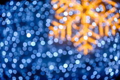 Blurred snowflake and lights background Stock Photos