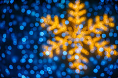 Blurred snowflake and lights background Stock Photo