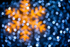 Blurred snowflake and lights background royalty free stock photography