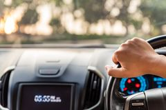 Blurred and Soft focus driver hands holding steering wheel. While driving on the road royalty free stock images